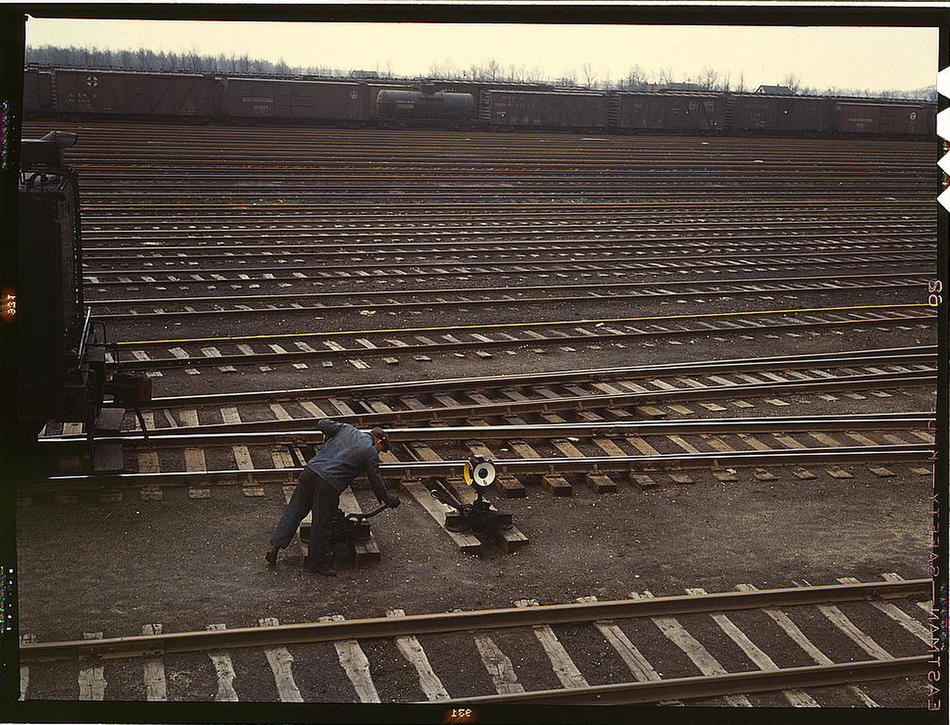 Switchman throwing a switch at Chicago and Northwest Railway Company Proviso yard Chicago, Illinois, April 1943. Photo by Jack Delano. Prints and Photographs Division, Library of Congress