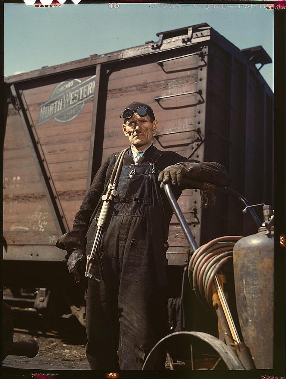 Welder Mike Evans at Proviso yard of the Chicago and Northwest Railway Company Chicago IL April 1943 Photo by Jack Delano Prints and Photographs Division, Library of Congress